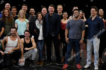 Australian singer Tina Arena and Brazilian singer Paulo Szot (C) pose for photographs with cast members following a rehearsal for the Opera Australia musical production of Andrew Lloyd Webber's Evita, in Sydney, Australia, 15 August 2018. Evita will play at the Sydney Opera House from 13 September, followed by a season at Arts Centre Melbourne from 05 December.