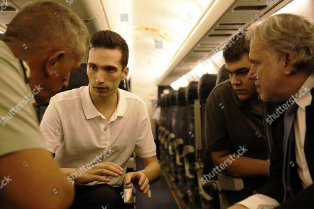 Greek lieutenant Aggelos Mitretodis (2-L) and noncommissioned officer Dimitros Kouklatzis (2-R) talk with the Greek Alternate Minister of Foreign Affairs George Katrougalos (R) and Deputy Chief of the HNDGS Lieutenant General Konstantinos Floros (R) during the flight from Turkey to Thessaloniki Airport in Thessaloniki, Greece, 15 August 2018. A Turkish court ruled on 14 August the release of two Greek officers that had been detained since March for entering a military zone in Turkey on the border with Greece. The Edirne court did not impose any restrictive travel measures on the two men, which means they will be allowed to return to Greece. During the court hearing, the two Greek officers and their lawyers sought their immediate release on the grounds that an examination of the digital devices held by the two men failed provide show any signs espionage. The two Greek officers told the court they had entered Turkey by mistake, following footprints which they had located on the Greek side. The judge agreed there is no evidence of espionage, deciding they will only face charges of illegally entering a military zone. Greek Prime Minister Alexis Tsipras said 'the release of the two Greek military officers is an act of justice, which will help to strengthen friendship, good neighborly ties and stability in the region.' 'I would like to congratulate and thank our two officers and their families for their courage, patience and confidence in the efforts of all of us, which were ultimately justified,' he added.