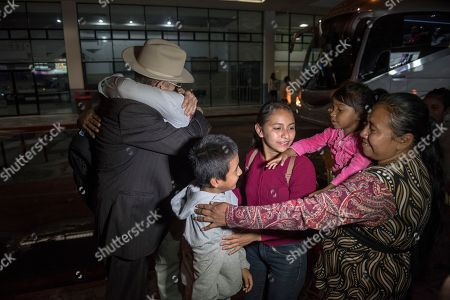 Relatives greet to Anthony David Tovar Ortiz, center, after arriving to La Aurora airport in Guatemala City, . The 8-year-old stayed in a shelter for migrant children in Houston after his mother Elsa Ortiz Enriquez was deported in June 2018 under President Donald Trump administration's zero tolerance policy