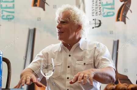 British conductor Sir Simon Rattle, music director of the London Symphony Orchestra, talks to members of the media ahead of his concert at the Santander International Festival, in Santander, northern Spain, 15 August 2018. The London Sympony Orchestra is to perform at the festival later the same day.