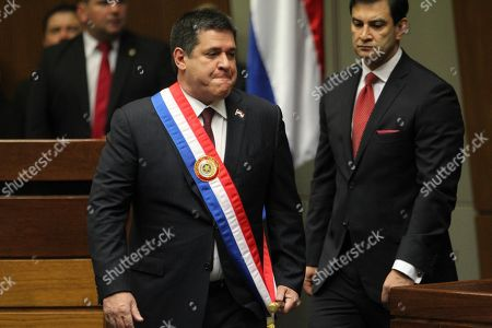 Paraguay's former President Horacio Cartes arrives in Congress for the ceremony to return the symbols of power, the sash and the baton, in Asuncion, Paraguay, . Mario Abdo Benitez succeeded him as Paraguay's 50th presidient
