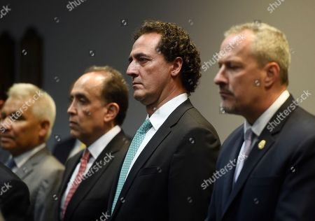 From left to right: Marco Antonio Ortega-Siu, admiral of the Mexican Marine Corps; Felipe de Jesus Munoz Vazquez, Mexico's Deputy Attorney General for the Specialized Investigation on Federal Crimes unit; Mexico's Attorney General Alberto Elias Beltran and Matthew Donahue, Drug Enforcement Administration regional director, stand during a news conference, in downtown Chicago