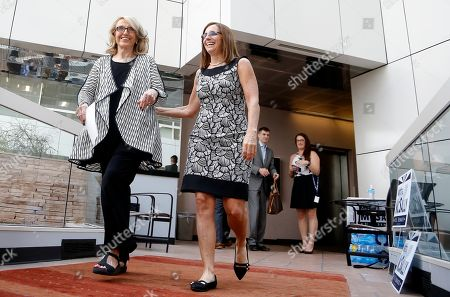 Rep. Martha McSally, R-Ariz., right, joins former Arizona Republican Gov. Jan Brewer, left, for a news conference at a campaign event for McSally's U.S. Senate primary race, in Phoenix. McSally, Kelli Ward and former Maricopa County Sheriff Joe Arpaio are vying for the Republican nomination, but there are no plans currently for a televised debate for the Republican candidates, on the Democratic side, Rep. Kyrsten Sinema and activist Deedra Abboud haven't had a televised debate either