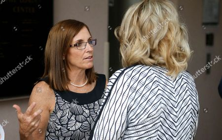 Rep. Martha McSally, R-Ariz., left, talks with former Arizona Republican Gov. Jan Brewer, right, prior to a news conference at a campaign event for McSally's U.S. Senate primary race, in Phoenix. McSally, Kelli Ward and former Maricopa County Sheriff Joe Arpaio are vying for the Republican nomination, but there are no plans currently for a televised debate for the Republican candidates, on the Democratic side, Rep. Kyrsten Sinema and activist Deedra Abboud haven't had a televised debate either