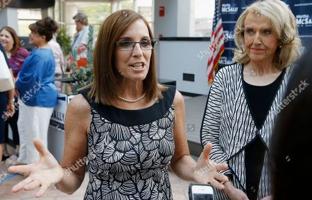 Rep. Martha McSally, R-Ariz., left, speaks to reporters after a news conference at a campaign event for her U.S. Senate primary race, as former Arizona Republican Gov. Jan Brewer, right, looks, in Phoenix. McSally, Kelli Ward and former Maricopa County Sheriff Joe Arpaio are vying for the Republican nomination, but there are no plans currently for a televised debate for the Republican candidates, on the Democratic side, Rep. Kyrsten Sinema and activist Deedra Abboud haven't had a televised debate either