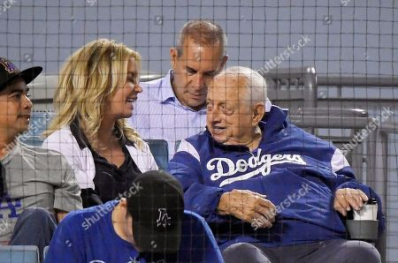 Jeanie Buss, Tommy Lasorda. Los Angeles Lakers president Jeanie Buss, left, talks with former Los Angeles Dodgers manager Tommy Lasorda during the fourth inning of a baseball game between the Dodgers and the San Francisco Giants, in Los Angeles