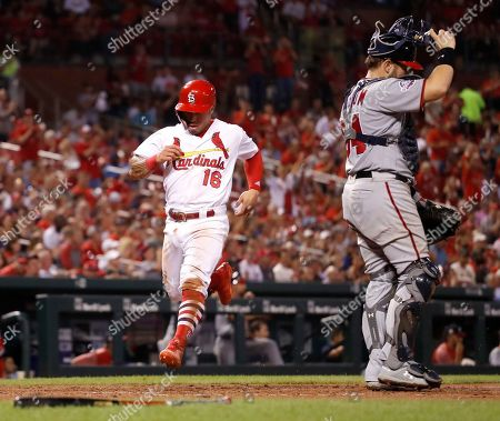 St. Louis Cardinals' Kolten Wong (16) scores past Washington Nationals catcher Spencer Kieboom during the seventh inning of a baseball game, in St. Louis