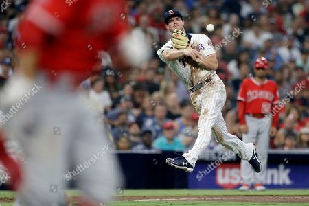 Wil Myers, David Fletcher. San Diego Padres third baseman Wil Myers, right, overthrows first base as Los Angeles Angels' David Fletcher, left, arrives with a single at first during the sixth inning of a baseball game, in San Diego