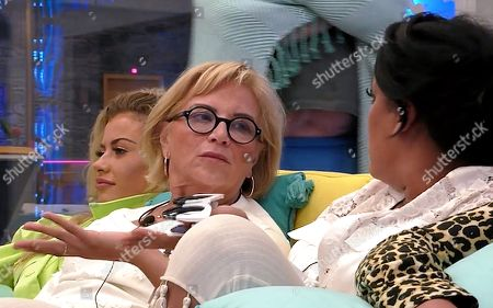 Sally Morgan watches as Natalie Nunn argues with the other housemates
