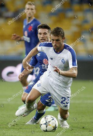 Josip Pivaric (F) of Dynamo vies with Mihail Baluta (B) of Slavia