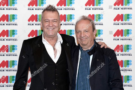 Australian singer Jimmy Barnes (L) and Australian film and television director Mark Joffe (R) pose for photographs during the world premiere of Working Class Boy at the Comedy Theatre in Melbourne, Australia, 16 August 2018. Joffe's new film Working Class Boy is based on Jimmy Barnes' bestselling memoir.