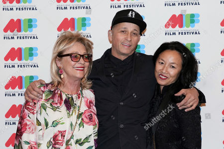 Sue Gudinski (L), Australian singer-songwriter and musician Mark Lizotte (C) and Jep Lizotte (R) pose for photographs during the world premiere of Working Class Boy at the Comedy Theatre in Melbourne, Australia, 16 August 2018. Joffe's new film Working Class Boy is based on Jimmy Barnes' bestselling memoir.