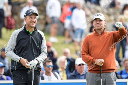 Sweden's Robert Karlsson (L) and Thomas Bjorn (R) of Denmark at the first tee during the first round of the Nordea Masters golf tournament at Hills Golf Club in Gothenburg, Sweden, 16 August 2018.