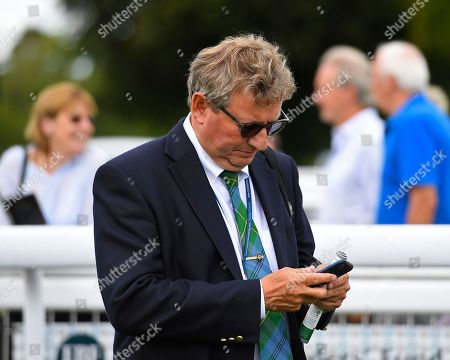 Sir Mark Johnson makes a call after The Tattersalls Sovereign Stakes  during Summer Holiday Family Races at Salisbury Racecourse on 16th August 2018
