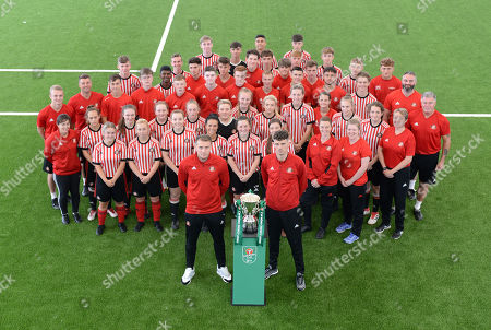 Charlie Wyke and Tom Flanagan of Sunderland at Sunderland Club Community Education Scheme poses for a picture with the boys and girls alongside the Carabao EFL Cup.