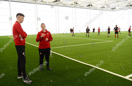 Tom Flanagan of Sunderland at Sunderland Club Community Education Scheme being shown around by Claire Robinson -technical director of the girls RTC