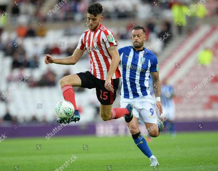 Jack Baldwin of Sunderland gets to the ball ahead of Steven Fletcher of Sheffield Wednesday