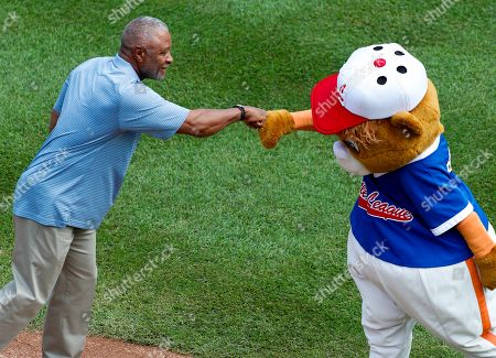 Eddie Murray. Baseball Hall of Famer Ozzie Smith, left, is greeted by Little League mascot Dugout before throwing out a ceremonial first pitch during the opening ceremony of the 2018 Little League World Series tournament in South Williamsport, Pa