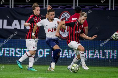 Player name. Tottenham Hotspur defender Anthony Georgiou (42) dribbles the ball between AC Milan defender Alen Halilovic (left) and defender Ignazio Abate (20) during an International Champions Cup soccer match, in Minneapolis. Tottenham Hotspur won 1-0