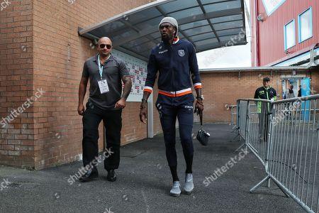 Emmanuel Adebayor of Istanbul Basaksehir arrives before the start of the match