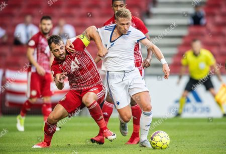 Nikolay Bodyrov (L) of CSKA Sofia and Viktor Fischer FC Copenhagen in action during the UEFA Europa League qualification match between FC Copenhagen and PFC CSKA Sofia, in Copenhagen, Denmark, 16 August 2018.