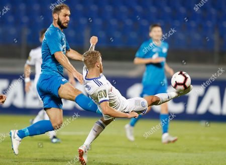 Zenit's Branislav Ivanovic, left, fights for the ball with Dinamo Minsk's Nikita Korzun during the UEFA Europa League, third qualifying round, second leg soccer match between FC Zenit and FC Dinamo Minsk at Petrovsky stadium in St.Petersburg, Russia