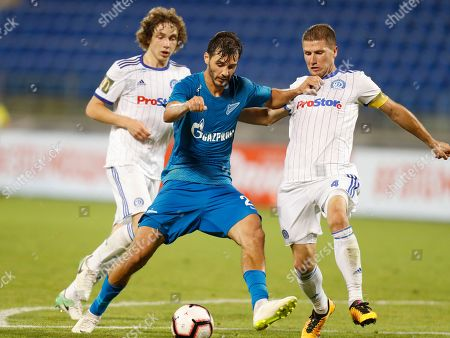 Zenit's Aleksandr Yerokhin, centre, fights for the ball with Dinamo Minsk's Maksim Shvyatsow, left, and Nino Galovic during the UEFA Europa League, third qualifying round, second leg soccer match between FC Zenit and FC Dinamo Minsk at Petrovsky stadium in St.Petersburg, Russia