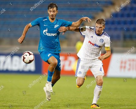 Zenit's Aleksandr Yerokhin, left, fights for the ball with Dinamo Minsk's Nino Galovic during the UEFA Europa League, third qualifying round, second leg soccer match between FC Zenit and FC Dinamo Minsk at Petrovsky stadium in St.Petersburg, Russia
