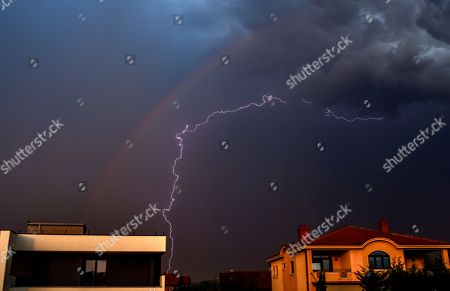 A Thunder Lightning And Rainbow Are Seen On The Sky Over Village Of Bardovci