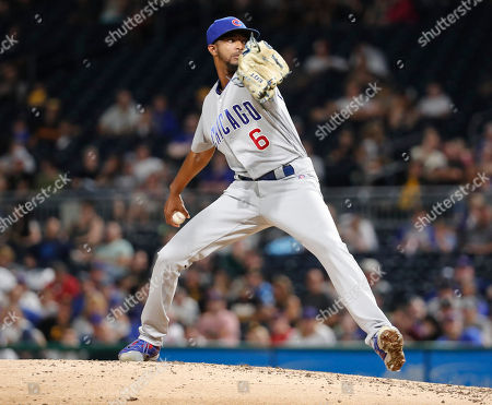 Chicago Cubs relief pitcher Carl Edwards Jr. throws against the Pittsburgh Pirates in the eighth inning of a baseball game, in Pittsburgh. The Cubs won 1-0