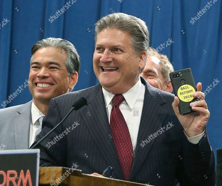 Stock Image of Rob Bonta, Robert Hertzberg. State Sen. Bob Hertzberg, D-Van Nuys, right and Assemblyman Rob Bonta, D-Alameda, left, celebrate during a news conference on the bill they co-authored to end money bail, after it was approved, in Sacramento, Calif. The Assembly Appropriations Committee advanced the bill, which will now be considered by the full Assembly