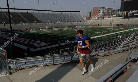 Manka Dhingra. Washington State redshirt freshman quarterback Connor Neville runs between fields during NCAA football practice, in Pullman, Wash
