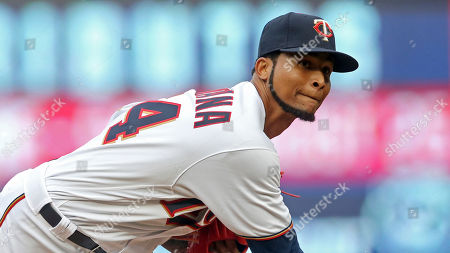 Minnesota Twins pitcher Ervin Santana throws against the Detroit Tigers in the first inning of a baseball game, in Minneapolis