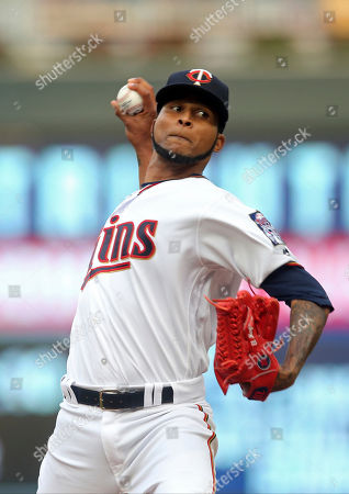 Minnesota Twins pitcher Ervin Santana throws against the Detroit Tigers in a baseball game, in Minneapolis