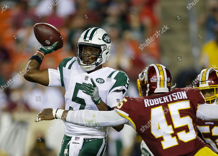New York Jets QB #5 Teddy Bridgewater gets a pass away just before Washington Redskins LB #45 Pete Robertson gets to him during a preseason NFL football game between the Washington Redskins and the New York Jets at FedEx Field in Landover, MD