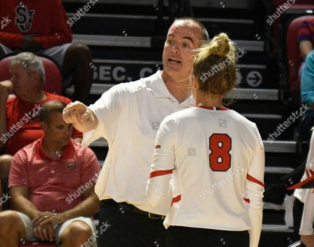 Western Kentucky Hilltoppers head coach Travis Hudson talks with Western Kentucky Hilltoppers setter Mary Martin (8) in the match between the Kentucky Wildcats and the WKU Hilltoppers, E.A. Diddle Arena in Bowling Green, KY. Photographer: Steve Roberts