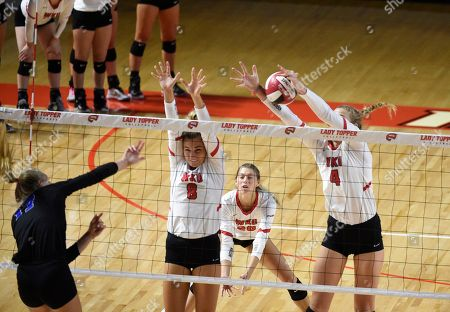 Western Kentucky Hilltoppers middle hitter Rachel Anderson (4) and Western Kentucky Hilltoppers setter Mary Martin (8) block the spike of Kentucky Wildcats defensive specialist Gabby Curry (12) in the match between the Kentucky Wildcats and the WKU Hilltoppers, E.A. Diddle Arena in Bowling Green, KY. Photographer: Steve Roberts