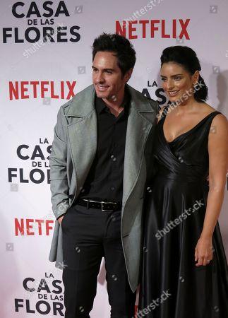 "Mexican actors Mauricio Ochmann and Aislinn Derbez pose for photos during a red carpet event promoting the Netflix series ""La Casa de las Flores"" in Mexico City"