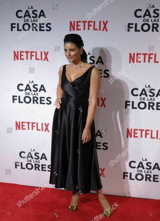 "Mexican actress Aislinn Derbez poses for photos during a red carpet event promoting the Netflix series ""La Casa de las Flores"" in Mexico City"