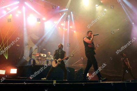 Brent Smith, Barry Kerch, Zach Myers, Eric Bass. Brent Smith, Barry Kerch, Zach Myers and Eric Bass with Shinedown performs as the opener for Godsmack at Cellairis Amphitheatre at Lakewood, in Atlanta