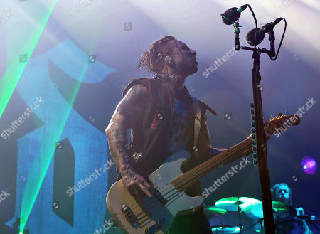 Eric Bass with Shinedown performs as the opener for Godsmack at Cellairis Amphitheatre at Lakewood, in Atlanta