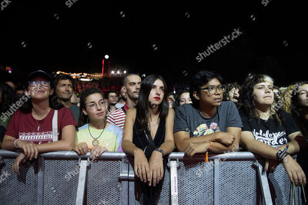 Stock Photo of People attend US rock band DIIV concert at 'Paredes de Coura' music festival, in Paredes de Coura, north of Portugal, 17 August 2018. The festival runs until 18 August.
