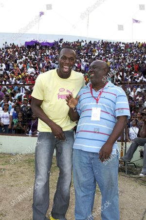 Usain Bolt and his Coach, Glen Mills at the Boys and Girls High School Championships, Kingston