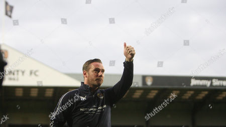 Notts County manager Kevin Nolan acknowledges the home crowd before kickoff