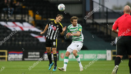 David Vaughan wins a strong header in the middle of the park for Notts