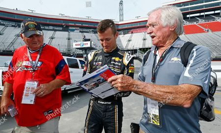 Stock Picture of Kasey Kahne signs autographs before practice for a NASCAR Cup Series auto race, in Bristol, Tenn. Kahne announced Thursday that he will retire from full-time racing in NASCAR and plans to focus on the sprint car team he owns