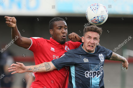 Dominic Poleon of Crawley challenges Joe Adams of Bury during the Sky Bet League 2 match between Crawley Town and Bury at the Broadfield Stadium in Crawley. 25 Aug 2018