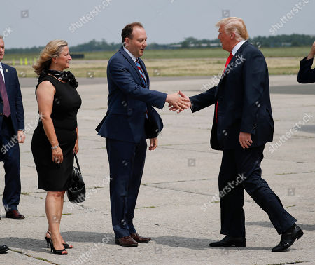 Donald Trump, Lee Zeldin, Maria Moore. President Donald Trump is greeted on the tarmac by Rep. Lee Zeldin, R-NY., center, and Maria Moore, left, Mayor of Westhampton Beach, NY., during his arrival on Air Force One at Francis S. Gabreski Airport in Westhampton, NY.,. Trump traveled to New York for a campaign fundraiser with supporters and will then travel to Bedminster, N.J, to spend the weekend at his private golf resort