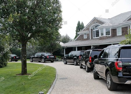 Motorcade vehicles accompanying President Donald Trump are seen parked in the driveway of the home of Howard Lorber, the executive chairman of New York City hot dog icon Nathan's Famous, in Southhampton, NY. Trump traveled to New York for a campaign fundraiser with supporters and is heading to Bedminster, N.J, to spend the weekend at his private golf resort