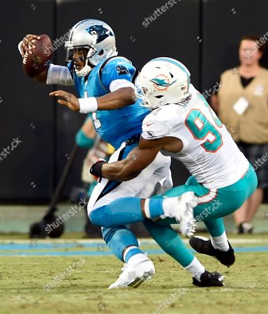 Carolina Panthers' Cam Newton (1) is sacked by Miami Dolphins' Robert Quinn (94) in the first half of a preseason NFL football game in Charlotte, N.C